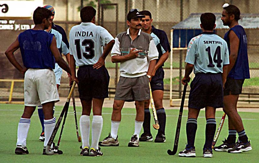 File photo of Indian hockey coach Cedric D' Souza with his players at the national hockey camp in Bangalore April 26, 2001. AFP