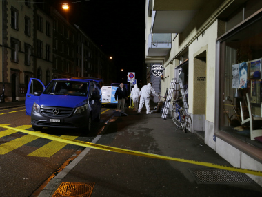 Forensic team investigates the scene after deadly gunfire was unleashed in Cafe 56, Basel, Switzerland. AP