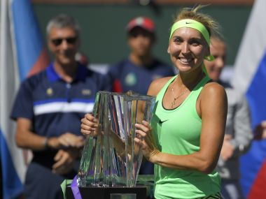 Elena Vesnina poses with the trophy after her win against Svetlana Kuznetsova. AP