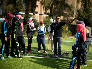 Palestinian baseball coach Mahmoud Tafesh gestures as he trains women in Khan Younis. Reuters