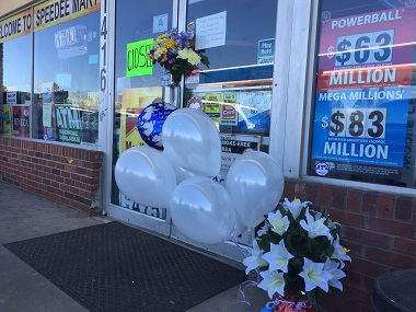 Boquets placed outside Harnish Patel's store in Lancaster, South Carolina. Image courtesy: Twitter/@Greg Suskin