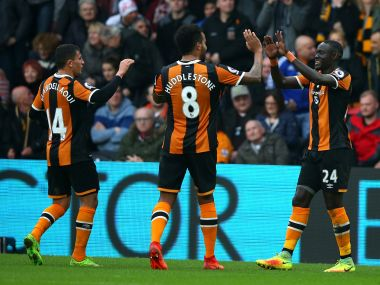 Oumar Niasse of Hull City (R) celebrates with teammates after scoring their second goal. Getty