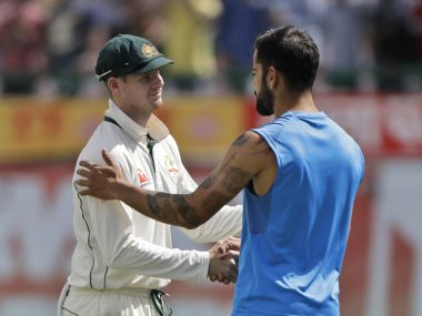 Australia's captain Steven Smith, left, and India's captain Virat Kohli shake hands after India won the fourth Test. AP