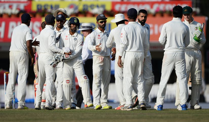 Indian team players shake hands with each other after the fifth day of the Ranchi Test. AP