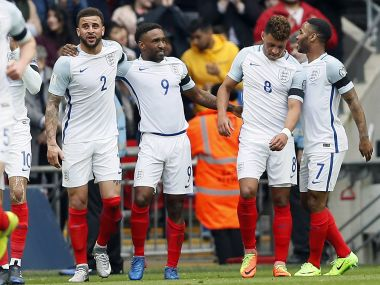 Jermain Defoe, third from right, celebrates coring with his England's teammates. AP Photo