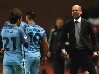 Pep Guardiola (right) gives instructions to Manchester City's David Silva (left) and Sergio Aguero during the match against Monaco. Getty Images