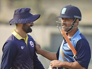 MS Dhoni (right) led Jharkhand into the semi finals of the Vijay Hazare Trophy. PTI