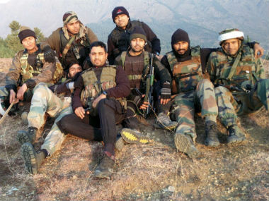 Major Rishi with members of his unit 42 Rashtriya Rifles.