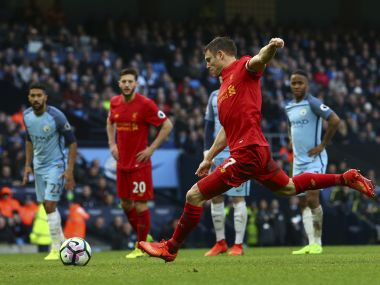 Liverpool's James Milner scores the opening goal from the penalty spot against Manchester City. AP