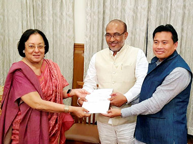 Manipur Governor Najma Heptulla handing over the invitation letter to BJP leader Nongthombam Biren Singh to form the government of Manipur at Raj Bhavan, Imphal, Manipur on Tuesday. PTI