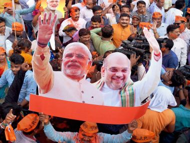 BJP workers celebrate after its big in Uttar Pradesh and Uttarakhand. PTI