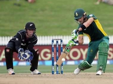 Faf du Plessis (R) of South Africa bats watched by Luke Ronchi of New Zealand (L). AFP