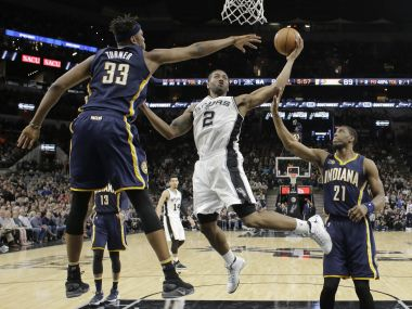 San Antonio Spurs forward Kawhi Leonard (2) drives to the basket against Indiana Pacers. AP
