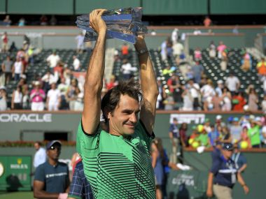 Roger Federer celebrates with the trophy after his win over Stan Wawrinka in the final. AP