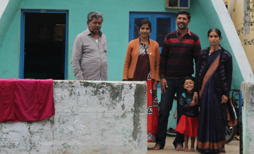 Thorthai Goodn, with his family in front of their traditionally shaped house. Firstpost/Sibi Arasu