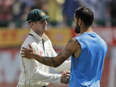 Steve Smith shakes hands with Virat Kohli at the end of the fourth Test in Dharamsala. AP