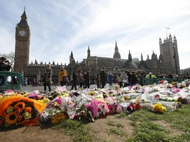 Floral tributes laid outside Parliament Square following the terror attack in Westminster. Reuters