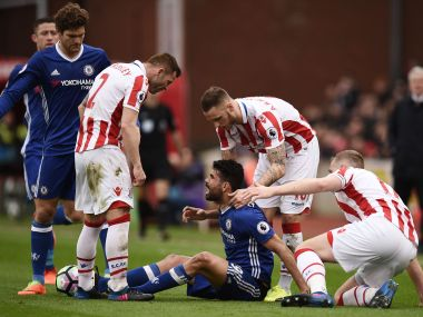 Chelsea's Diego Costa (centre) has words with Stoke City players. AFP