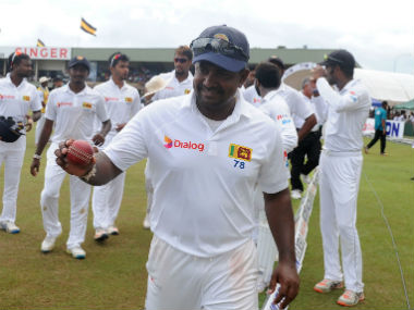 Rangana Herath leaves the grounds after victory in the first Test between Sri Lanka and Bangladesh in Galle. AFP