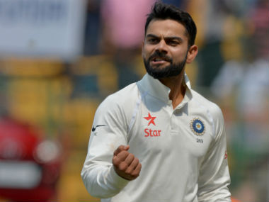 Virat Kohli reacts as he walks back to the pavilion for tea during the second Test. AFP