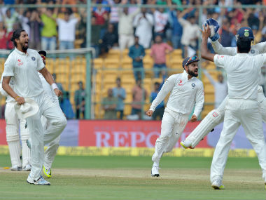 Virat Kohli and his teammates celebrate their victory against Australia in the 2nd Test against Australia in Bengaluru. AFP