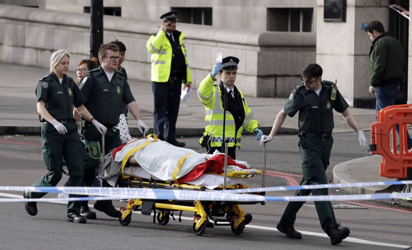 Emergency services staff provide medical attention close to the Houses of Parliament in London on Wednesday. AP