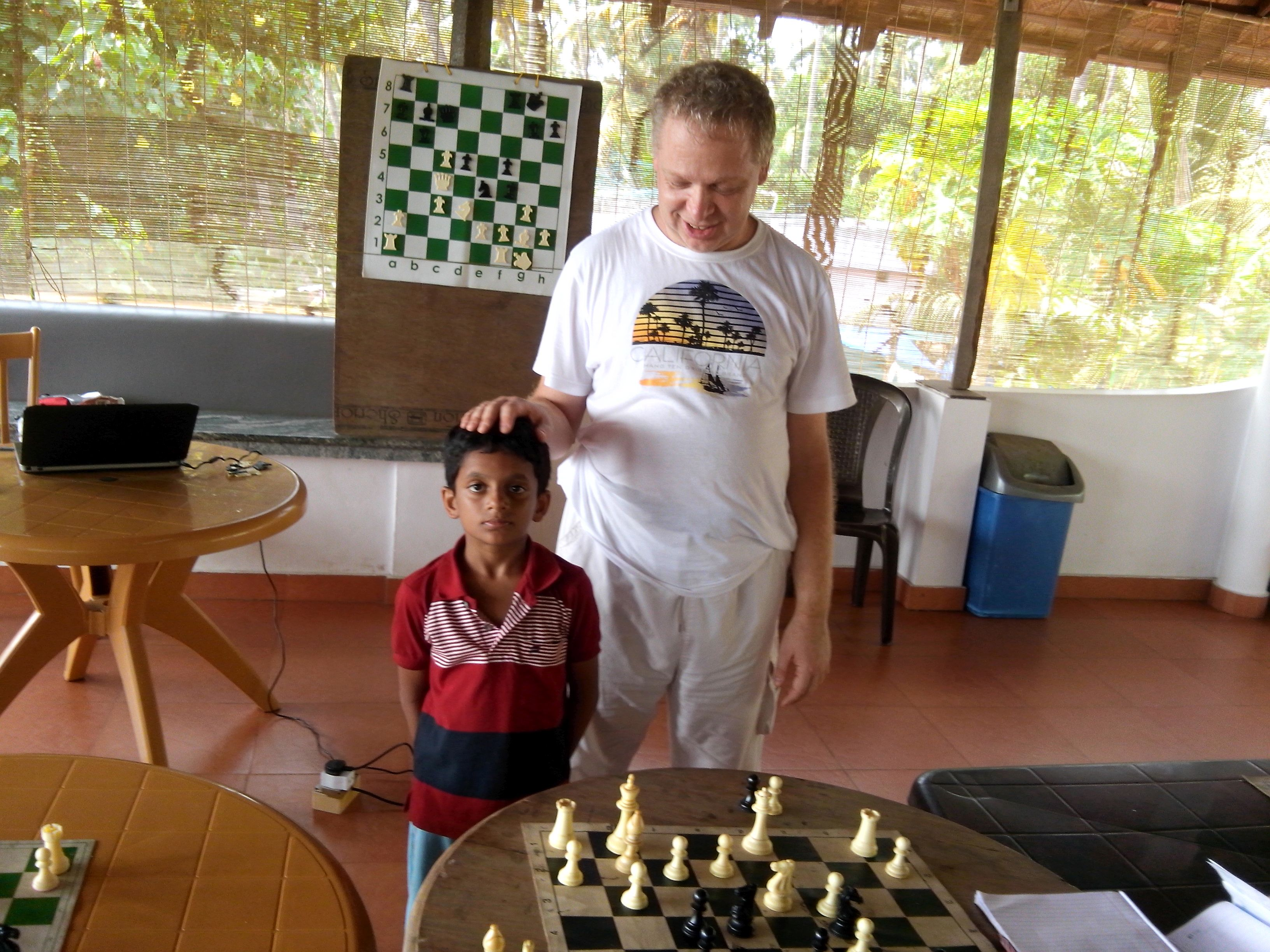 Nihal with his guide, Ukrainian Grand Master Dimitri Komarov.