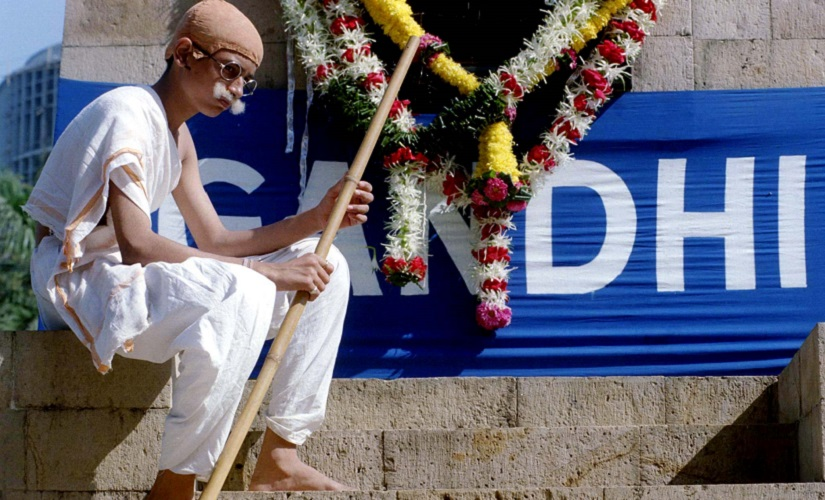 A fifteen-year-old school boy plays Mahatma Gandhi in a play during a public function to mark the 50th anniversary of his assassination in Bombay January 30. Gandhi, who is considered the architect of India's independence from British rule, was shot at point blank range in 1948 by Nathuram Godse, a militantly right-wing Hindu. INDIA - RTRAWL5