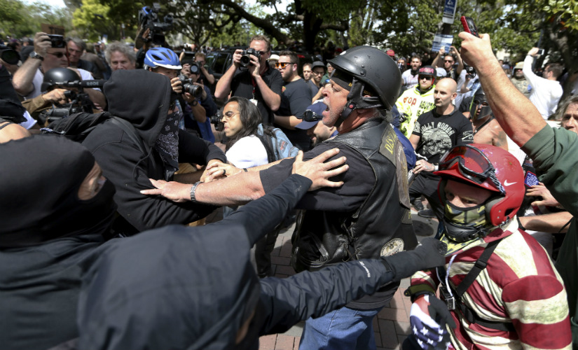 Anti and pro-Donald Trump supporters clash during competing demonstrations at Martin Luther King Jr. Civic Center Park in Berkeley, Calif., Saturday, April 15, 2017.