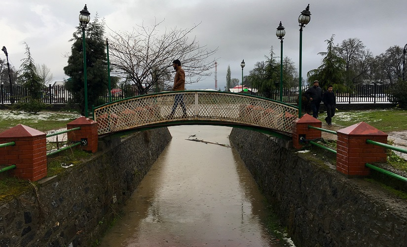 A man walks on a pathway bridge in a park next to River Jhelum after the floods. Firstpost/Sameer Yasir