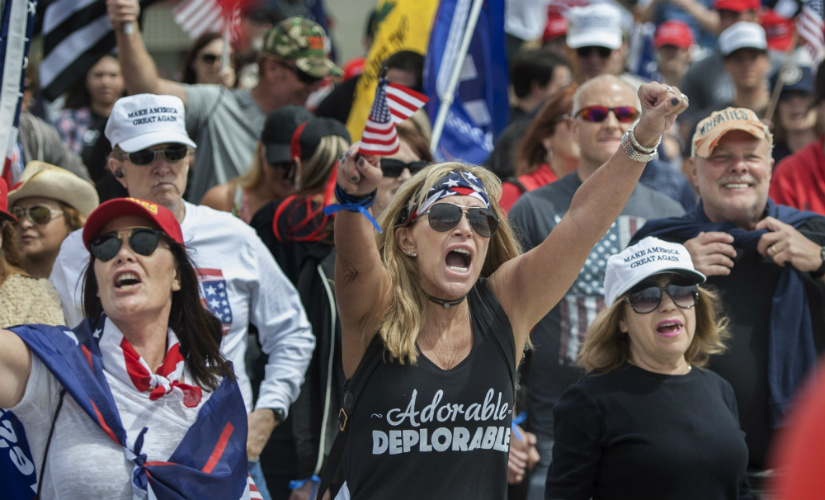 "Wearing her ""Adorable Deplorable"" tee, Deanne Payn, center, with Sheila Ponce, left, take part in a pro-President Donald Trump rally in Huntington Beach, Calif., on Saturday, March 25, 2017."