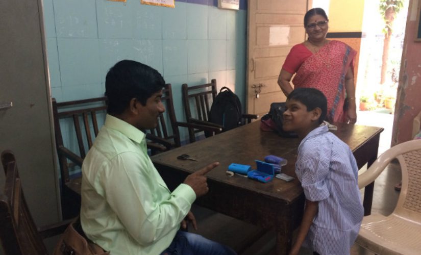 Sunil Bhadane, special educator, Sarva Shiksha Abhiyan, with Javed Shaikh whom he spotted four years ago. Bhadane earns Rs 20,000 per month–based on an allowance per child–and works six days a week. IndiaSpend