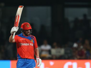 Gujarat Lions' Aaron Finch raises his bat after reaching his fifty against Royal Challengers Bangalore. Sportzpics/IPL