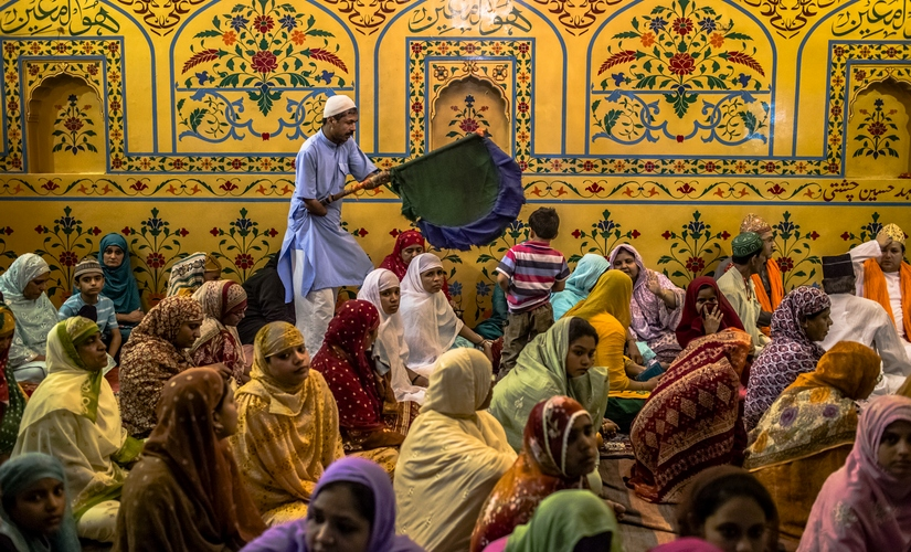 An image of devotees at the Sufi shrine, Ajmer Sharif Dargah. Getty