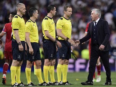 A disgruntled Carlo Ancelotti meets the referees after Bayern Munich's controversial to Real Madrid. AFP