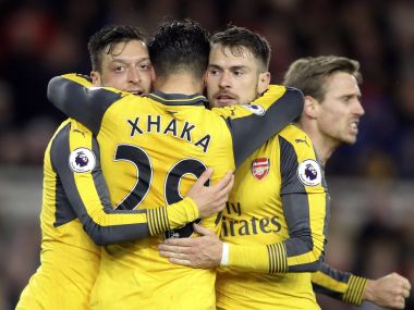 Arsenal's Mesut Ozil, left, celebrates with teammates after scoring. AP