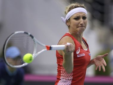 Timea Bacsinszky, of Switzerland, returns a ball during the Fed Cup semi-final. AP