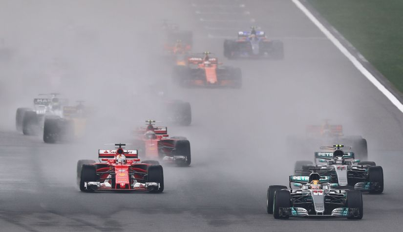 Lewis Hamilton leads Sebastian Vettel and the rest of the field at the start during the Chinese Grand Prix. Getty