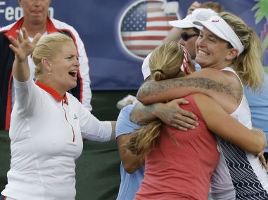 United States captain Kathy Rinaldi celebrates with players Shelby Rogers and CoCo Vandeweghe. AP