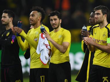 Dortmund's players react after the match against Monaco. AFP