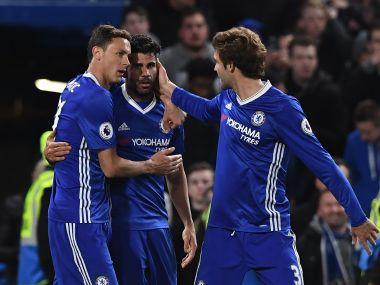 Chelsea's Diego Costa celebrates with teammates after scoring their fourth goal. AFP
