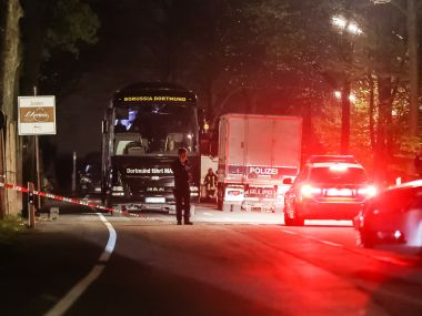 Police stand near the team bus of Borussia Dortmund after it was damaged in an explosion. Getty
