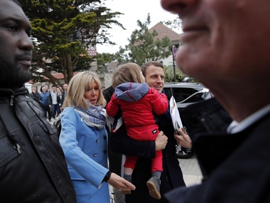 Independent centrist presidential candidate Emmanuel Macron and his wife Brigitte Trogneux arrive at their home in Le Touquet Paris Plage, northern France, Saturday, April 22, 2017. Macron is a newcomer in politics with strong pro-business, pro-European views that could make him France's next president. AP