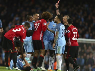 Manchester United's Marouane Fellaini, center, is sent off during the match against Manchester City. AP