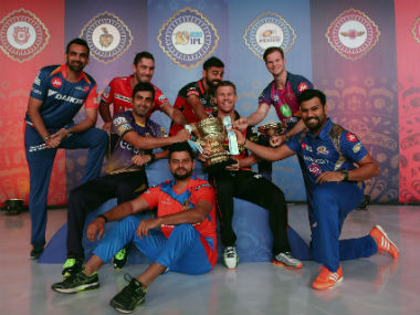 The team captains share a light-hearted moment with the trophy ahead of the tournament opener. Image courtesy: IPL via Twitter