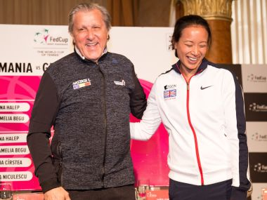 Ilie Nastase and Anne Keothavong pose for photos ahead of their Fed Cup tie. Getty