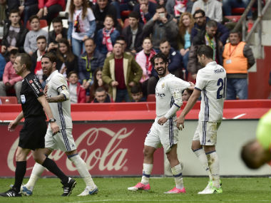 Real Madrid's Isco celebrates his last-gasp goal against Sporting Gijon. AP