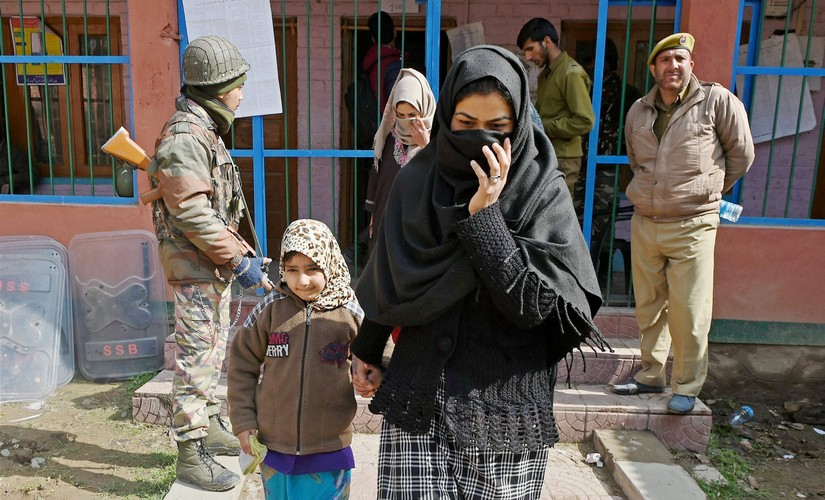 Women coming out from a polling station after casting their vote for Srinagar Parliamentary constituency of Jammu and Kashmir at Budgam in Srinagar. PTI