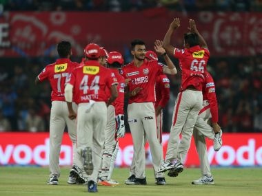 Axar Patel is congratulated by Kings XI Punjab teammates. IPL/Sportzpics