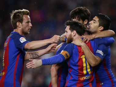 Barcelona's Lionel Messi, center, celebrates with his teammates after scoring. AP
